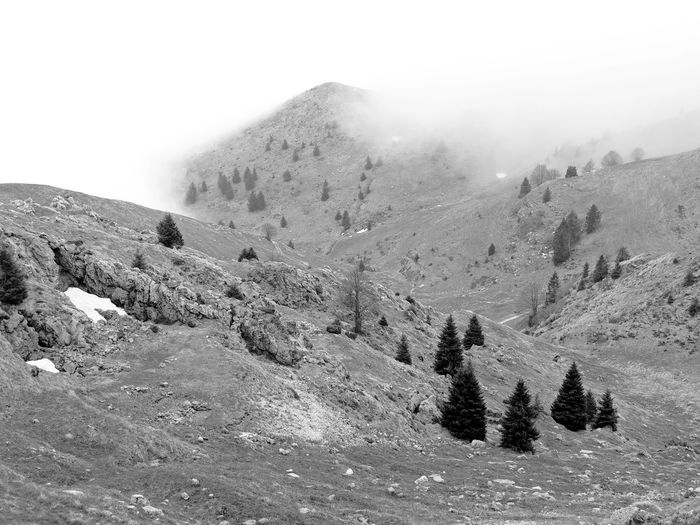 Scenic view of snow covered mountains during foggy weather