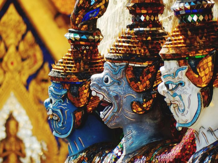 Close-Up Of Statues Of Demons In Buddhist Temple