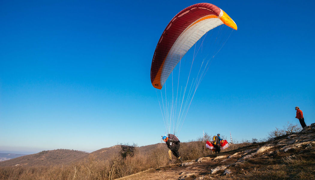 Adult Adults Only Adventure Beauty In Nature Blue Day Hot Air Balloon Landscape Leisure Activity Nature One Man Only One Person Outdoors Parachute Paragliding People Scenics Sky