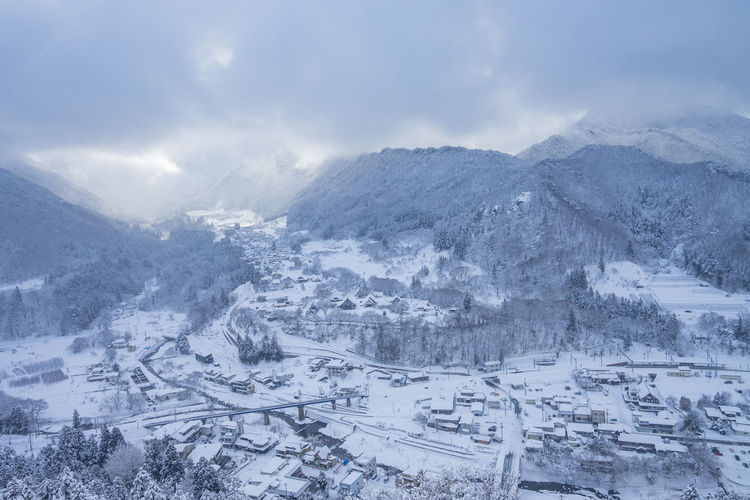 Cold Temperature Snow Winter Mountain Environment Landscape Scenics - Nature Nature Cloud - Sky Sky City Beauty In Nature Mountain Range No People Travel Tourism Tranquil Scene Outdoors Travel Destinations Range Snowcapped Mountain