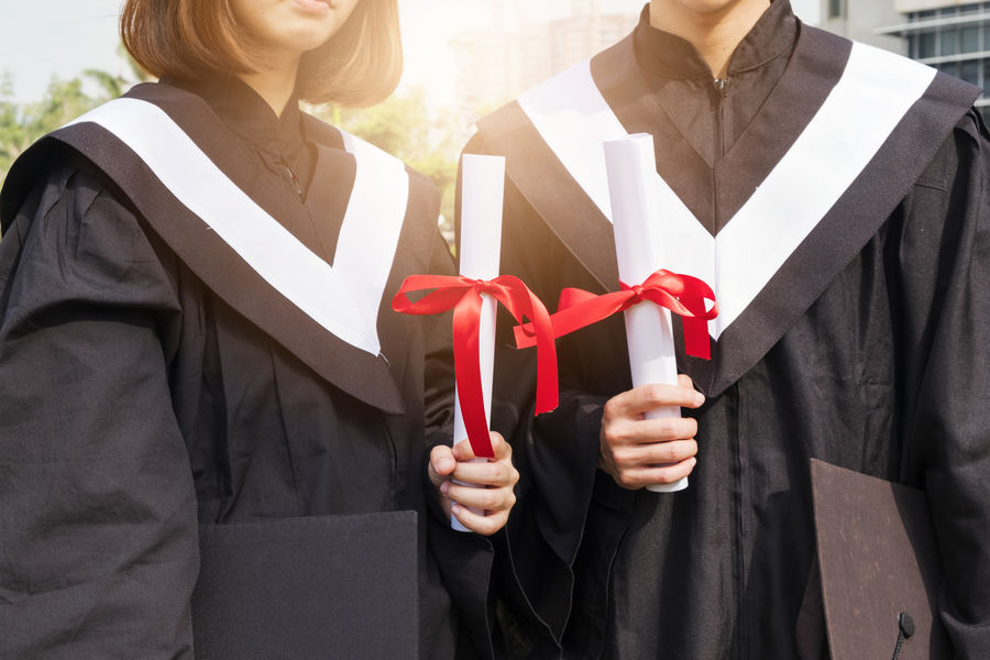 Asian  Graduation Japan Student Unıversıty Adult Bow Celebration Chinese Couple - Relationship Focus On Foreground Front View Gift Holding Lifestyles Men Midsection People Real People Red Ribbon Ribbon - Sewing Item School Standing Tied Bow Two People University University Student Women Young Adult