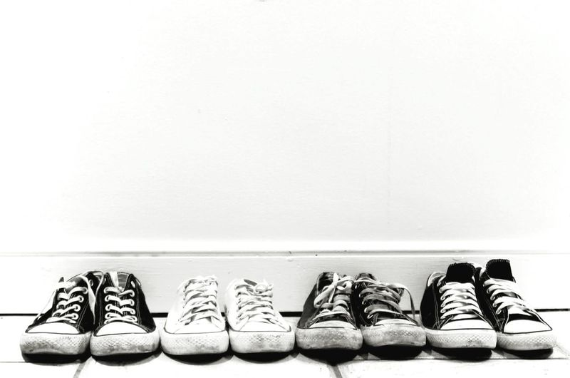 Canvas shoes against wall at home