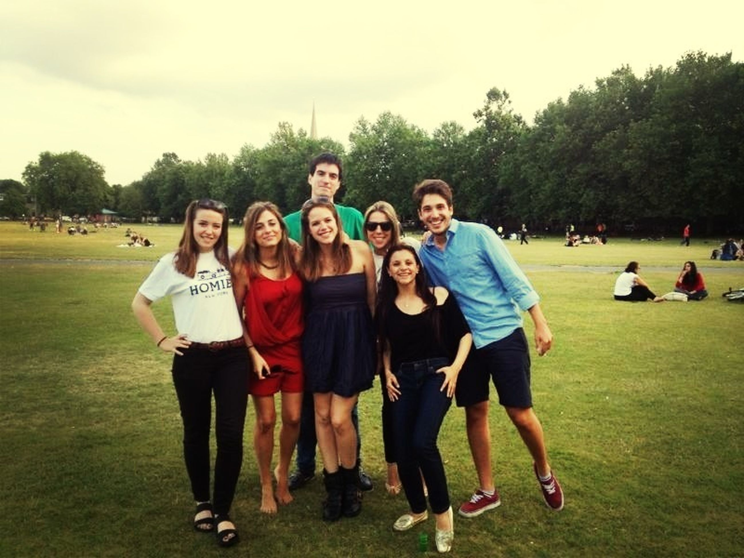 lifestyles, leisure activity, togetherness, grass, casual clothing, happiness, large group of people, enjoyment, friendship, fun, bonding, smiling, person, portrait, tree, looking at camera, men, green color, front view