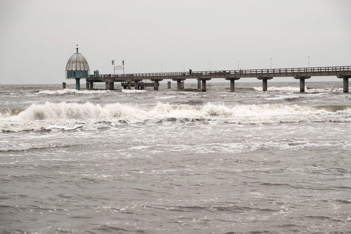 Baltic Bridge Sea Wave Water Built Structure Architecture Pier Beach Surf Scenics Clear Sky Motion Incidental People Horizon Over Water Shore Nature Beauty In Nature Tranquil Scene Outdoors Day Tranquility Seebrücke Seabridge Baltic Sea Zinnowitz
