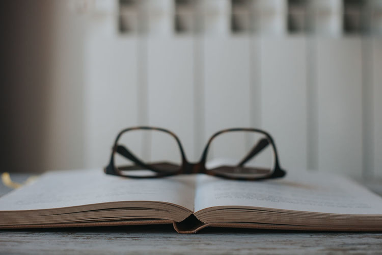 Book Old Books Eyeglasses  Glasses Close-up Page Still Life Publication Education Eyeglasses  Indoors  Table No People Paper Focus On Foreground Open Literature Selective Focus Wisdom Positive Emotion Personal Accessory Studying Learning Reading