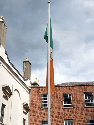 Salute to the Irish flag... Flag Building Exterior Patriotism Architecture Cloud - Sky Low Angle View Sky No People Day Built Structure Outdoors