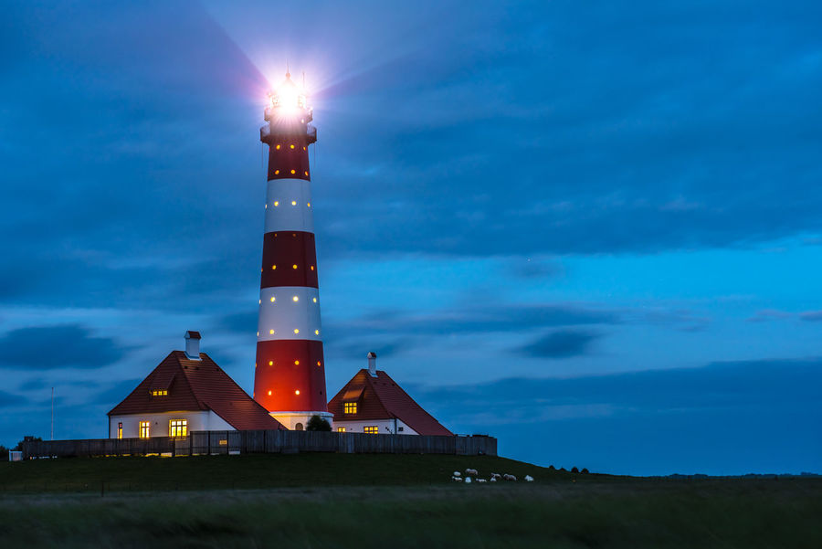 Architecture Building Exterior Built Structure Cloud - Sky Grass Guidance Illuminated Lighthouse Nature Night No People Outdoors Protection Sky Sunset Tower Weltnaturerbe Wattenmeer World Heritage Site By UNESCO