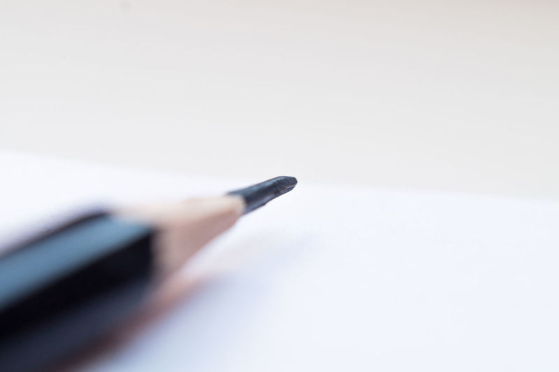 High angle view of pen on table against white background