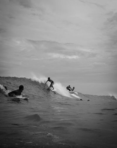 Surfers Riding Waves