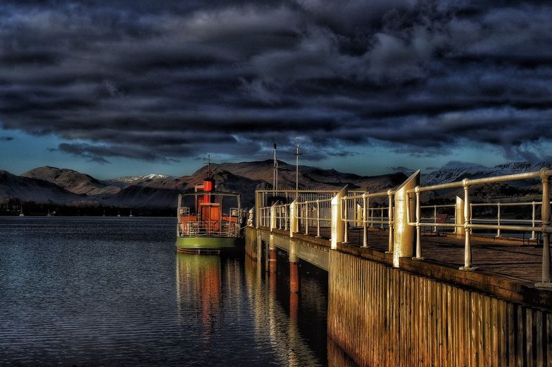 Ullswater Steamer, parked up for the night under a dark cloud blanket. Taking Photos EyeEm Nature Lover Landscape Beauty In Nature Tranquility The Lake District  Countryside Malephotographerofthemonth Photography Is My Escape From Reality! Ullswater Tranquil Scene Clouds And Sky Boats⛵️ Reflection Sunset Showcase April