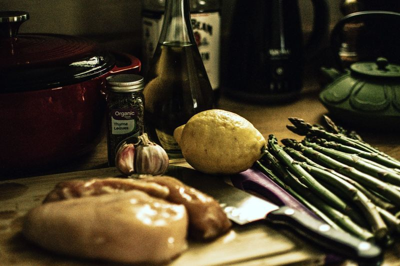 Lemon chicken Asparagus Garlic Thyme Olive Oil Chopping Board Dinner Dinner Time Food Food Preparation Food Prep Foodphotography Homemade Kitchen Light Beams Shawdows Light And Shadow Dutch Oven Dutch Oven Diaries Home Is Where The Art Is