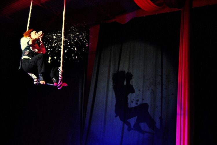 Blind lady Trapeze Trapeze Artist Full Length Hanging Red Acrobat Circus Stage Light Stage Acrobatic Activity Gymnastics Leotard Entertainment Tent Aerobatics
