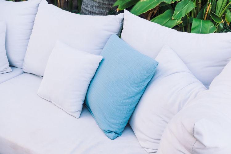 High angle view of cushions on sofa at back yard