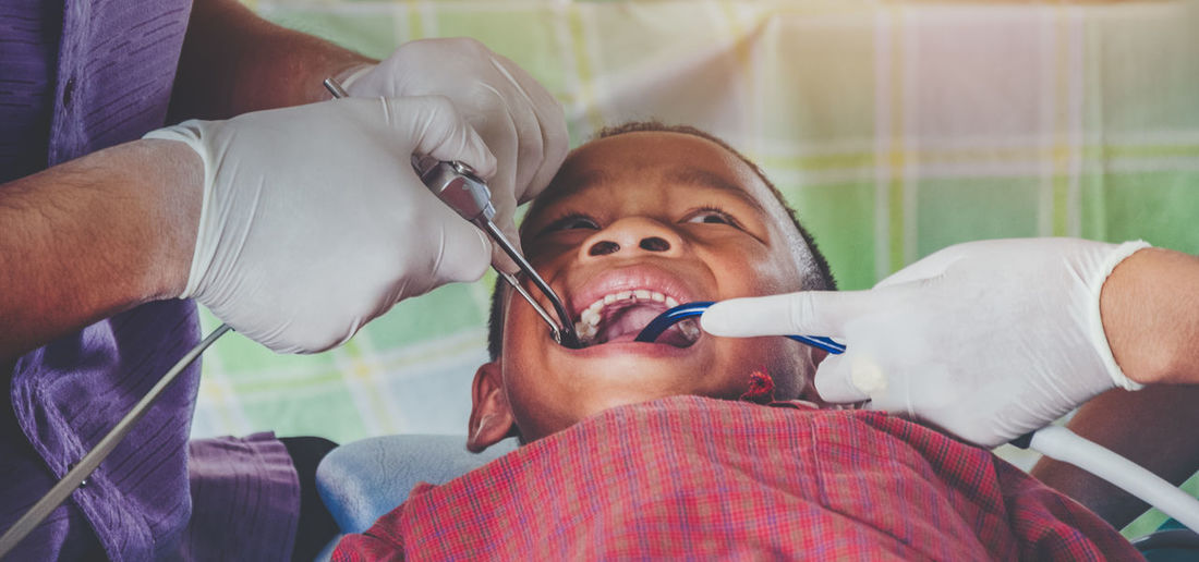 Dental Adult Care Child Childhood Doctor  Expertise Front View Headshot Healthcare And Medicine Hospital Indoors  Looking At Camera Males  Medical Equipment Men Occupation Patient People Portrait Real People Teeth Two People