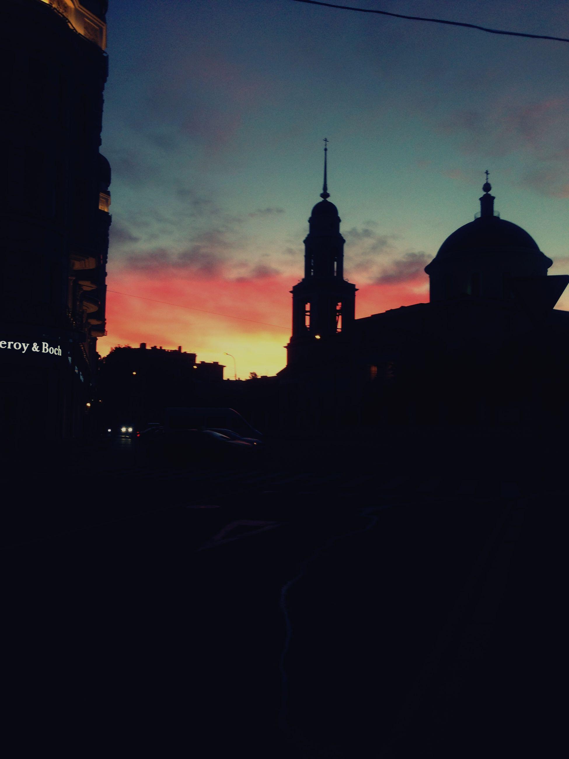 building exterior, architecture, sunset, built structure, sky, silhouette, church, religion, place of worship, transportation, dusk, orange color, spirituality, cloud - sky, city, dome, tower, cloud