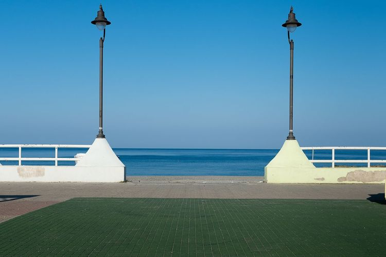 Water Sea Sky Street Light Nature Horizon Over Water Clear Sky Beach Horizon No People Lighting Equipment Beauty In Nature Tranquil Scene Sunlight Outdoors Tranquility