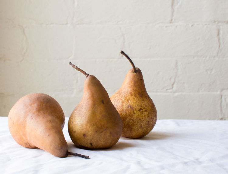 Three pears Apple - Fruit Close-up Day Food Food And Drink Freshness Fruit Group Of Objects Healthy Eating Indoors  No People Pear Still Life Table Three Objects Wall Wall - Building Feature Wellbeing White Color