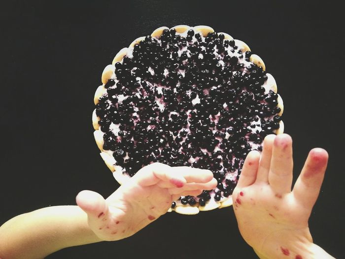 Sweet Food Food And Drink Human Body Part One Person Indulgence Dessert Food Ready-to-eat Real People Black Background Freshness Childhood Blueberry Pie Touch Kids Eating Kids Hands Kids Baking Fruit Cake  Seasonal Fruits Blueberries