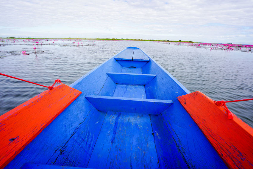 Water Nautical Vessel Transportation Mode Of Transportation Day Blue Sea No People Sky Nature Scenics - Nature Beauty In Nature Wood - Material Cloud - Sky Outdoors Tranquil Scene Tranquility Red Red Lotus In Thailand Red Lotus Lake