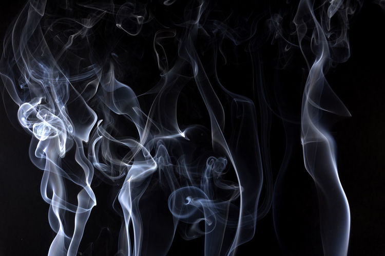 White Smoke Against Black Background