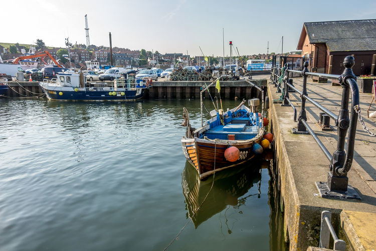 Whitby Whitby Harbour Whitby View Whitby North Yorkshire North Yorkshire Yorkshire Tourist Destination Sunny Day Blue Sky Seaside Seaside Town Fishing Boat Fishing Industry Nautical Vessel Reflection Sky Harbor Day No People Waterfront Water Moored Sea Clear Sky Sailboat