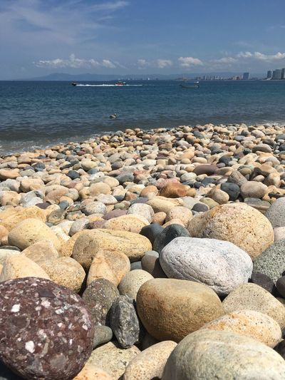 Sea Water Beach Pebble Rock - Object Nature Sky Beauty In Nature Tranquility Outdoors Tranquil Scene Scenics Cloud - Sky Pebble Beach Horizon Over Water Day No People No Filter