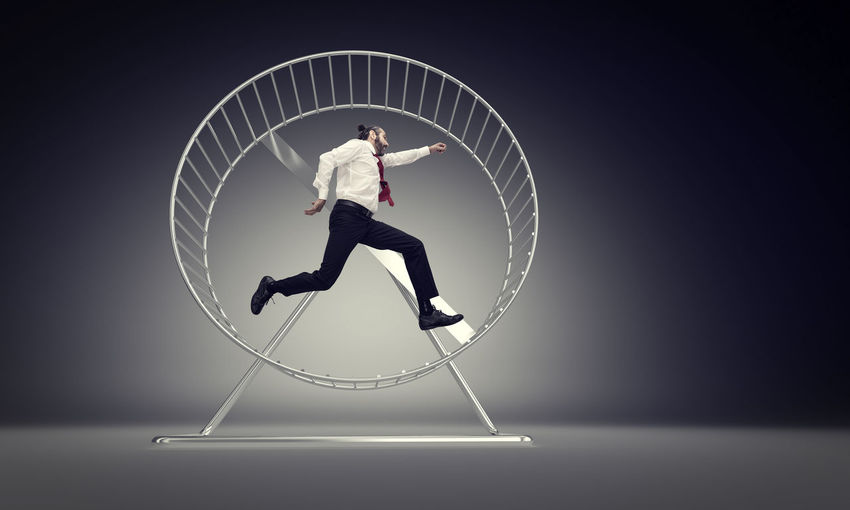 3D Rendering Run Hamster Businessman Man Worker Challenge Business Competition Race Concept Wheel Hurry Slave Work Routine Job Gear Motivation Stress Exercise Power Caucasian Manager Speed Office Career Hardworking Time Success Loop Active Urgency Unsuccessful Energy Exhausted Inefficient Tired Frustration Runner Powering Generation Production