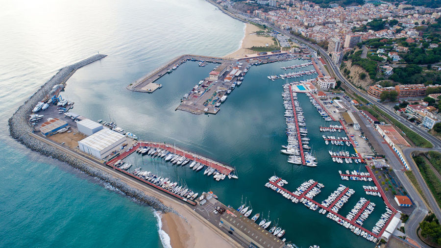 High angle view of commercial dock by sea in city