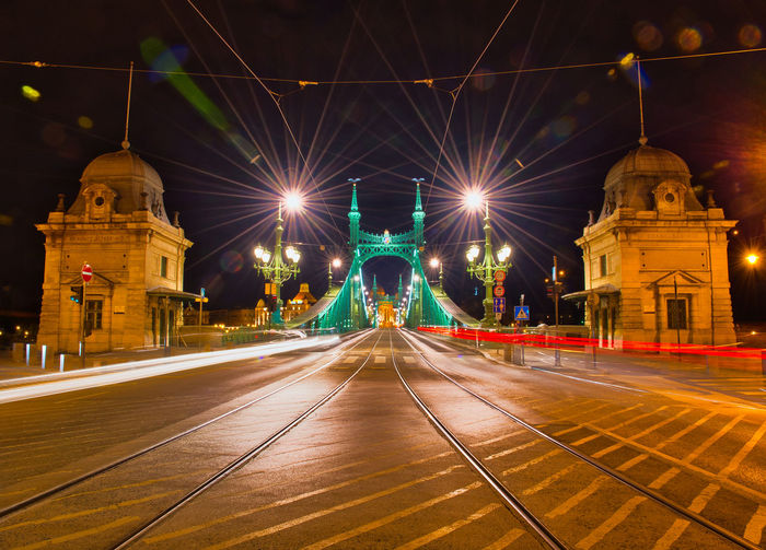 Liberty Bridge glowing TheWeekOnEyeEM Nightphotography Night Lights Budapest Budapest, Hungary Hungary🇭🇺 Liberty Bridge Budapest Bridge Budapest By Night City Cityscape Illuminated Urban Skyline Bridge - Man Made Structure Architecture Light Trail Vehicle Light Light Painting Long Exposure Street Light HUAWEI Photo Award: After Dark