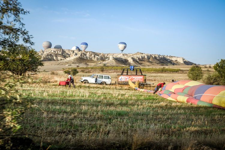 View of hot air balloons on field