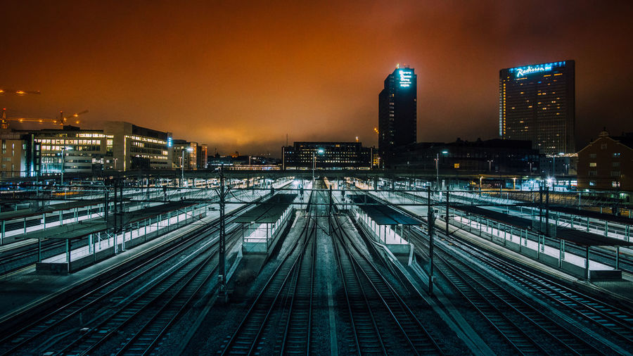 High angle view of railway tracks at night