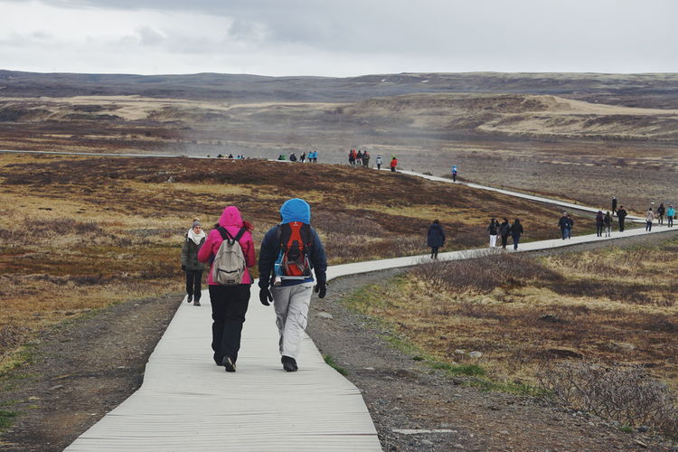 People hiking Adult Adventure Beauty In Nature Day Full Length Golden Waterfall Hiking Iceland Iceland_collection Landscape Leisure Activity Lifestyles Mountain Mountain Range Nature Outdoors People Real People Scenics Sky Standing The Golden Circle The Golden Waterfall Togetherness Walking The Great Outdoors - 2017 EyeEm Awards The Great Outdoors - 2017 EyeEm Awards The Great Outdoors - 2017 EyeEm Awards