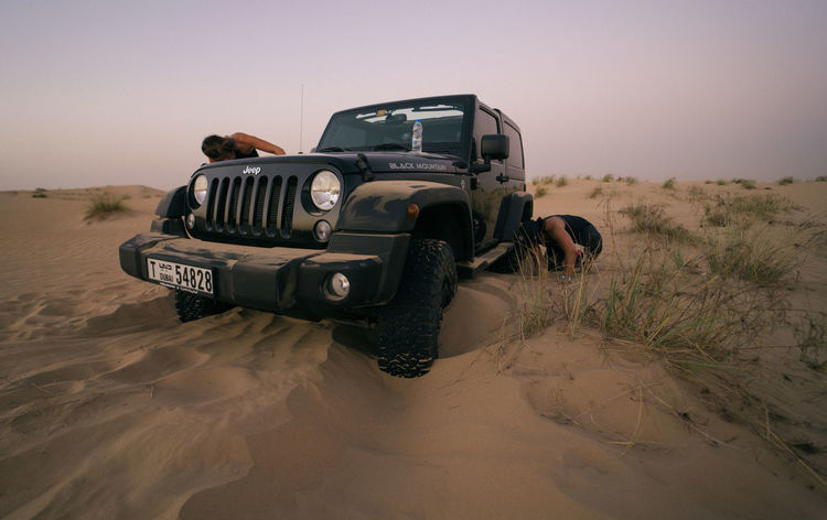 EyeEm Selects Desert Mode Of Transport Off-road Vehicle Adventure Transportation Car Sand 4x4 Sand Dune People Arid Climate Adult Sky Beauty In Nature Sunset Nature Scenics Desert Landscape Jeep Wrangler  Jeep Jeep Life Outdoors Day