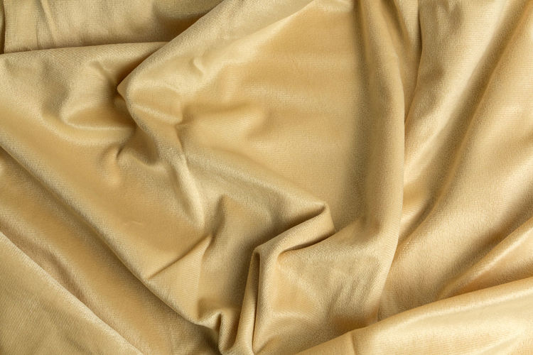 Abstract Abstract Backgrounds Backgrounds Bed Bright Crumpled Folded Full Frame Indoors  Luxury Material No People Pattern Rippled Satin Shiny Silk Smooth Softness Textile Textured  Textured Effect Wealth Wrinkled Yellow