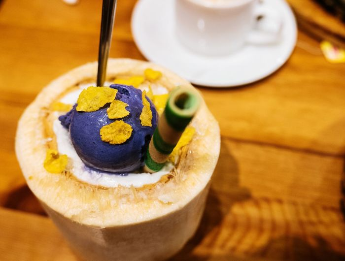 Ice Cream Scooped And Served Inside Of Tropical Fruit Shell