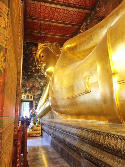 Reclining Buddha at Wat Pho Buddhism Culture Be Humble Bangkok Wat Pho Travel Religion Spirituality Statue Sculpture Male Likeness Place Of Worship Gold Travel Destinations Idol