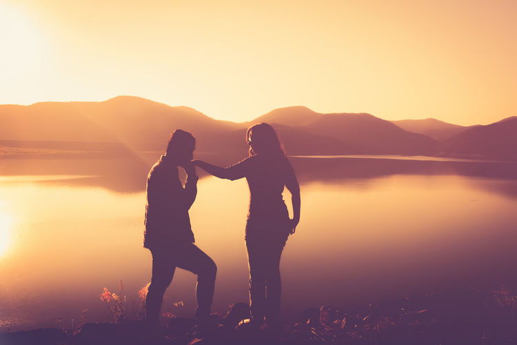 love nature Beauty In Nature Bonding Clear Sky Couple - Relationship Friendship Full Length Leisure Activity Lifestyles Love Men Mountain Nature Outdoors Real People Romance Scenics Sea Silhouette Sky Standing Sunset Togetherness Two People Water Women