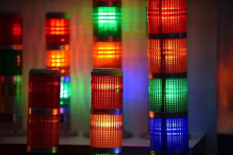 Close-up of illuminated multi colored lights at night