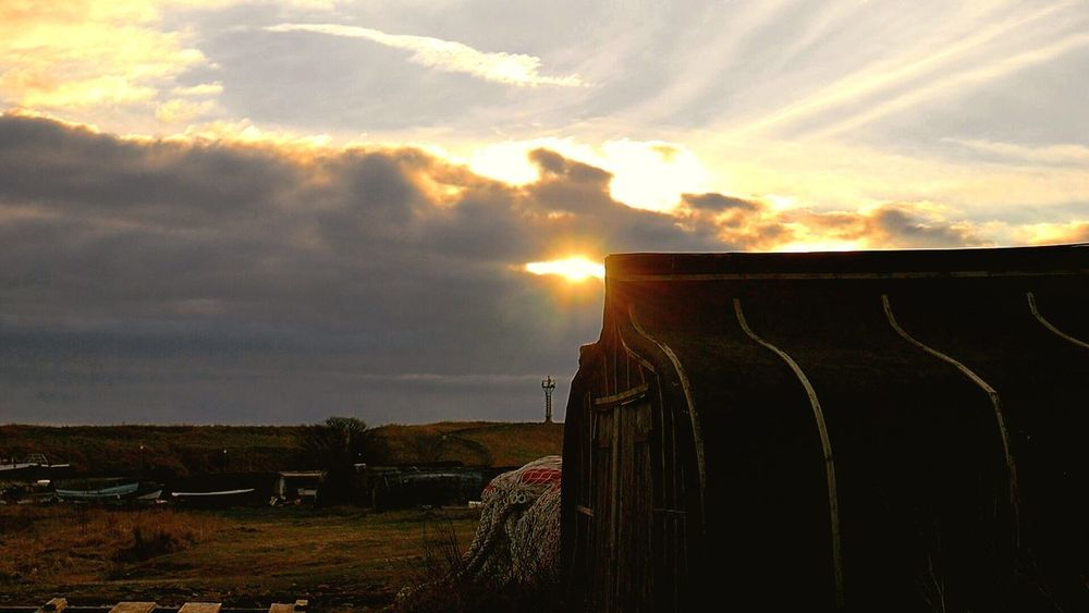 Fishermens Hut Upturned Boat Lindisfarne Bay Sunset Sky Sunlight Cloud - Sky Sun Nature Beauty In Nature No People Outdoors Scenics Tranquility Sunbeam Day