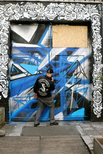 Berlin Architecture Art And Craft Art In Progress Building Exterior Built Structure Casual Clothing Child Creativity Day Door Entrance Full Length Graffiti Human Representation One Person Outdoors Paint Street Art Teenager Text Wall - Building Feature Window