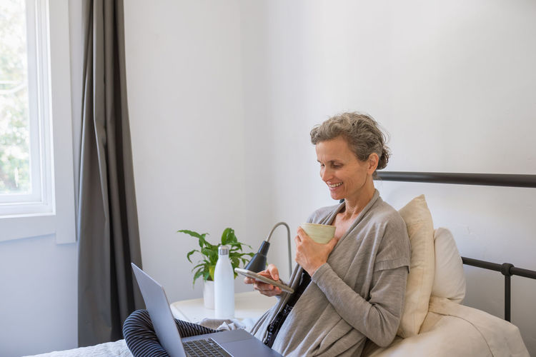 Woman looking away while sitting at home