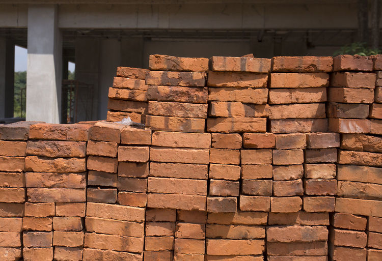 Brick Architecture Built Structure Brick Stack No People Large Group Of Objects Day Brown Construction Industry Abundance Industry Sunlight Construction Site Outdoors Wall - Building Feature Wall Repetition Brick Wall Arrangement Pattern Architectural Column Concrete