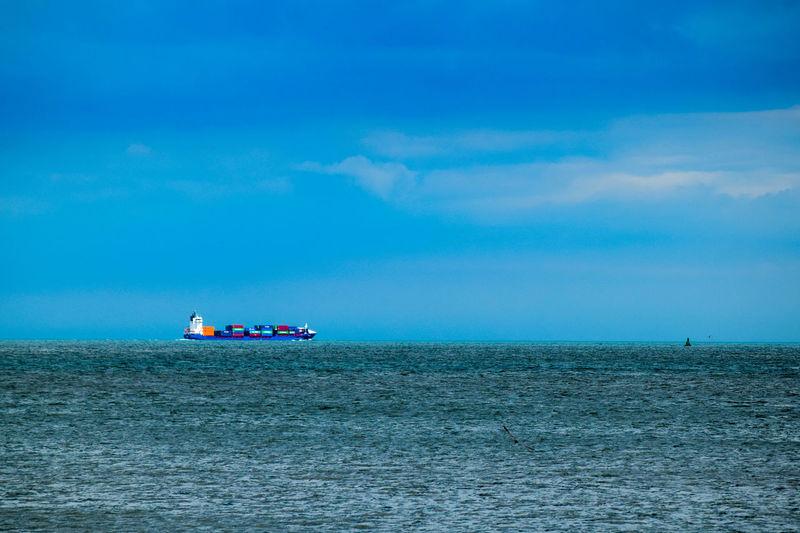 Cargo ship sailing in sea