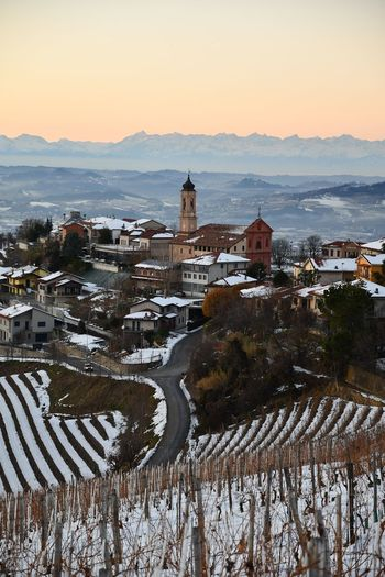 Langhe Tranquility Beauty In Nature Hills Top Of The Hills Vineyards  Outdoor Travel Winter Sunset Village View Snowed Village Winter Snowed Hills Snowed Landscape Snowy Vineyards In Winter Winter Landscape Winter Sunset Outdoors Snow Travel Destinations No People Cold Temperature Architecture Vacations Landscape Sky Day Nature