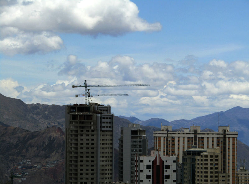 Building skyscrapers in La Paz, Bolivia. City Construction High La Paz, Bolivia New Skyline Architecture Building Cityscape Clouds Cranes And Construction Creating Day Higher Mountain No People Outdoors Range Sky Skyscraper
