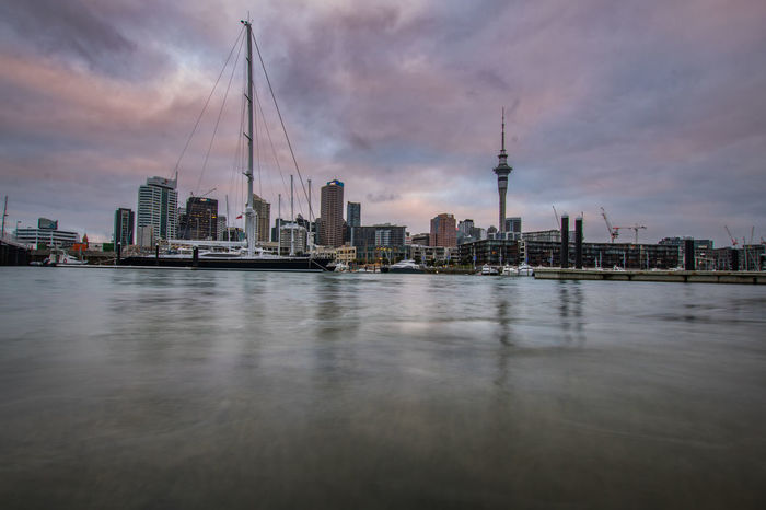the skyline of auckland at the harbour in the evening Auckland Travel Architecture Building Building Exterior Built Structure City Cityscape Cloud - Sky Financial District  Landscape Modern New Zealand No People Office Building Exterior Outdoors Sky Skyscraper Tall - High Tourism Tower Travel Travel Destinations Urban Skyline Water The Architect - 2018 EyeEm Awards