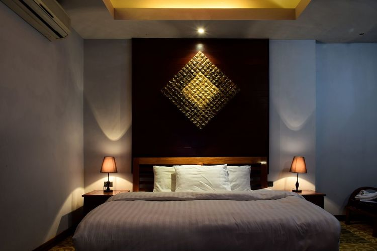 Illuminated interior of bedroom at home