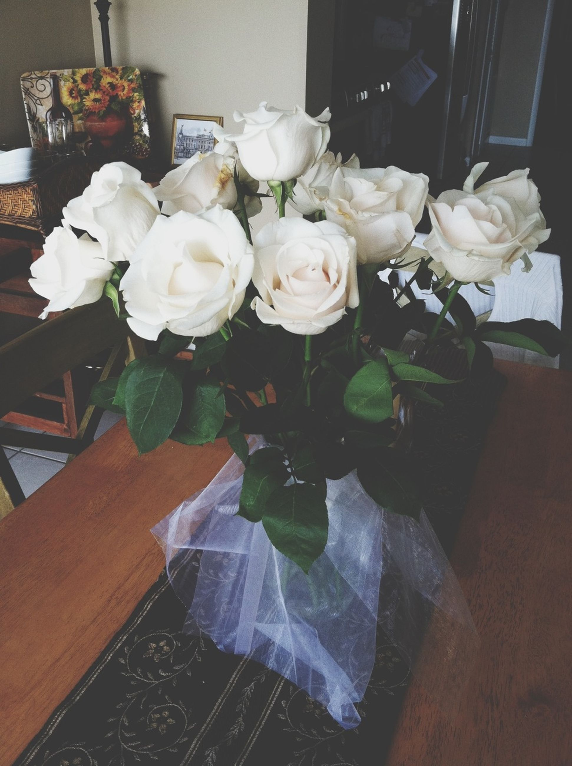 flower, indoors, freshness, fragility, vase, petal, table, flower head, rose - flower, white color, flower arrangement, bunch of flowers, beauty in nature, bouquet, home interior, growth, nature, decoration, high angle view, plant