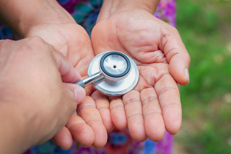 Health care check up. Care Body Part Care Check Up Close-up Day Finger Focus On Foreground Hand Health Healthcare And Medicine Healthy Holding Human Body Part Human Finger Human Hand Lifestyles Medical Equipment Medical Supplies Men People Real People Selective Focus Silver Colored Unrecognizable Person