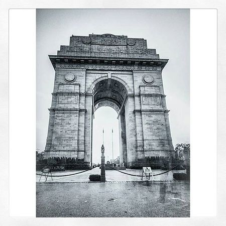 """Across Rajpath in Central Delhi at the eastern end is laid a huge archway that is made of stone and is a pride that resembles victory. The monument is raised to a height of 42 meters and is formerly known as India Gate. On original basis, the place was also known by the name of All India War Memorial on the basis of which the foundation of this prestigious monument is laid. The foundation stone of India Gate of Delhi was laid by the Duke of Connaught and Designed by Sir Edwin Lutyens. The construction of India Gate of Delhi was completed in February 1921 and the building was dedicated to Lord Viceroy at the time of 1931 namely, Lord Irwin. Also known as the 'All India War Memorial', the India Gate India Gate in Delhi was constructed as a memorial in honor of 90,000 soldiers who sacrificed their lives during World War I and also the Third Anglo Afghan War. In 1971 following the Bangladesh Liberation war, a small simple structure, consisting of a black marble plinth, with reversed rifle, capped by war helmet, bounded by four eternal flames, was built beneath the soaring Memorial Archway. This structure, called Amar Jawan Jyoti, or the Flame of the Immortal Soldier, since 1971 has served as India's Tomb of the Unknown Soldier. India gate details that designing of this monument was conducted under supervision of Sir Edwin Lutyens. The pillar along with whole monument representing the gate of India is built over the stone platform including Red Bharatpur stone along with the cornice elements also available. If you have a look at the monument, you will find that INDIA in bold letters is encrypted on either ends of the monument. Flanked by the dates MCMXIV (1914 left) and MCMXIX (1919 right). Below the word INDIA, is inscribed, in capital letters: """" TO THE DEAD OF THE INDIAN ARMIES WHO FELL HONOURED IN FRANCE AND FLANDERS MESOPOTAMIA AND PERSIA EAST AFRICA GALLIPOLI AND ELSEWHERE IN THE NEAR AND THE FAR-EAST AND IN SACRED MEMORY ALSO OF THOSE WHOSE NAMES ARE RECORDED AND W"""